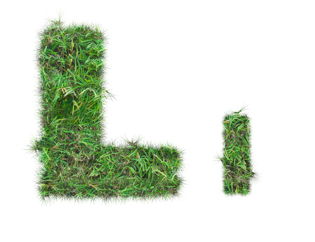 letter L on green grass isolated on over white background