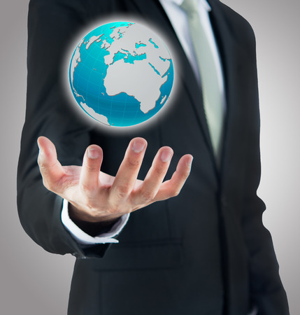 Businessman standing posture hand holding Earth icon isolated on over gray background photo