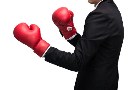 Businessman standing posture in boxing gloves isolated on over white background photo