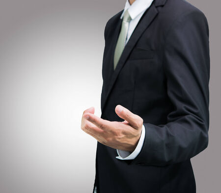 businessman standing: Businessman standing posture show hand isolated on over gray background