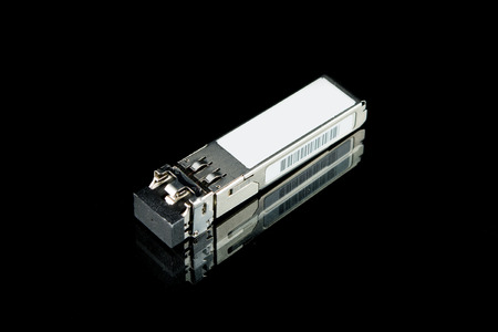 Optical gigabit SFP module for network switch isolated on over black background