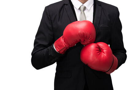 padding: Businessman standing posture in boxing gloves isolated on over white background Stock Photo