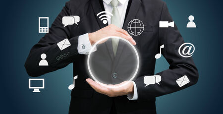 Businessman holding cloud computing network on dark background photo