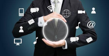 Businessman holding cloud computing network on dark background photo