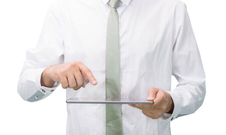 Businessman standing posture hand holding blank tablet isolated on over white  photo