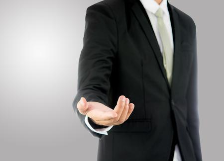 Staat de zakenman bevindende die houding hand op over grijs wordt geïsoleerd Stockfoto - 31048634