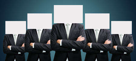Businessman standing white paper face holding front of head on dark background photo