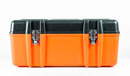 Orange toolbox isolated on over white background