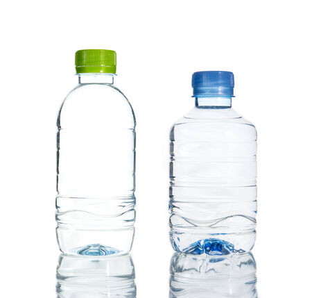 water spring: Plastic water bottle isolate on over white background