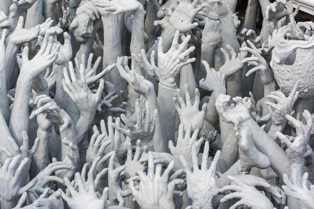 Devils Hands from Hell, one of many beautiful decorations in Rong Khun Temple in Chiang Rai of Thailand photo