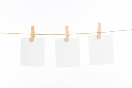 paper cards hanging rope isolated on white background Stockfoto