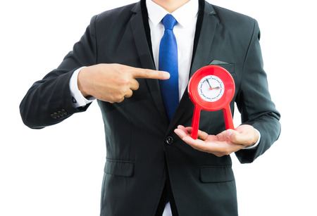 Red clock holding in businessman hands isolated on over white background photo