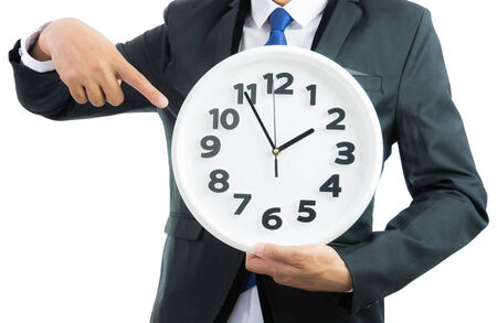 White clock holding in businessman hands isolated on over white background photo