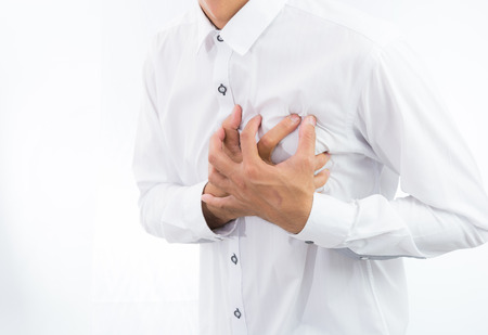 tightness: businessman having heart attack isolate on over white background Stock Photo