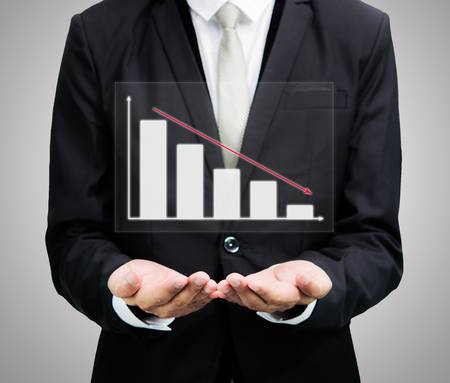 Businessman standing posture hand holding graph finance isolated on over gray background