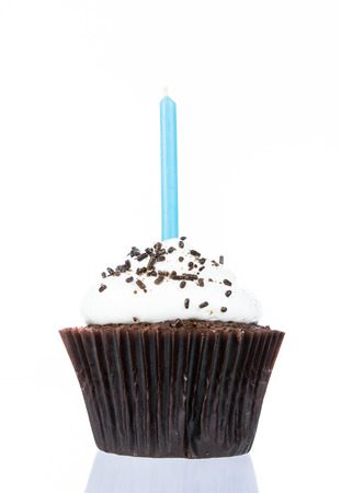 Birthday cupcake with candle isolate on over white background Stockfoto