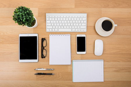 Business desk with a keyboard, mouse and pen on wooden table
