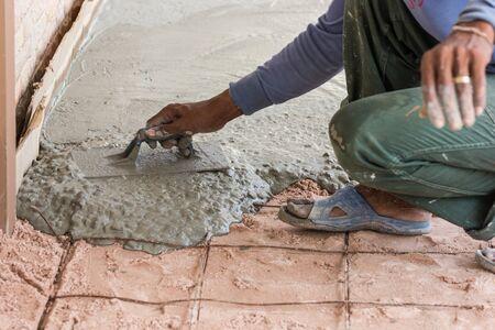 plasterer: Plasterer concrete cement floor in the home