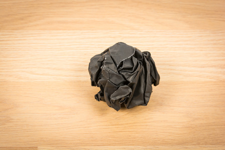 corrugate: Black paper ball corrugate on wooden background