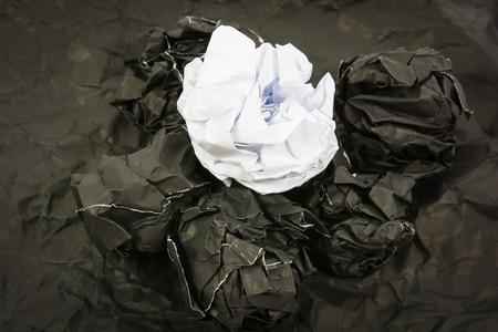 corrugate: Black paper ball corrugate on black paper background