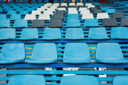 bleachers: Sport stadium plastic chairs on bleachers view row Stock Photo