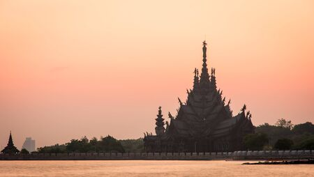 Silhouette Sanctuary of Truth temple construction on sunset in Pattaya, Thailand photo
