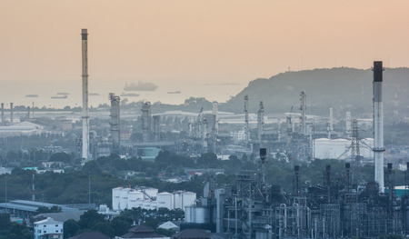 Light of petrochemical industry power station on sunset of Thailand photo