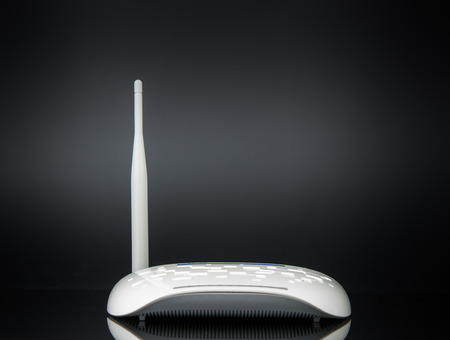 Wireless modem router network hub on black background Banque d'images