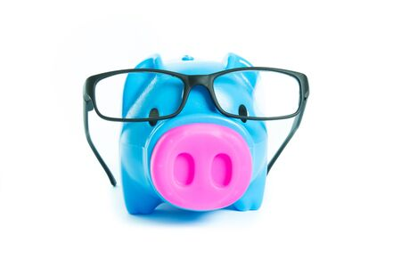 Piggy bank with glasses isolated on over white background photo