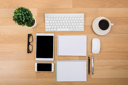 Business desk with a keyboard, mouse and pen on wooden table photo