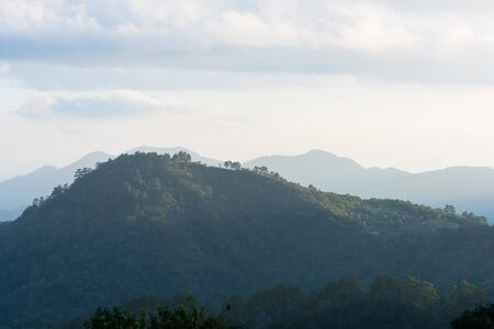 faintly visible: Sunset in the mountains at Doi Ang Khang of Thailand Stock Photo