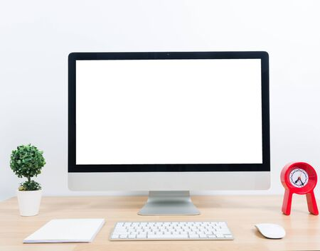blank tablet: Office monitor computer, mouse on wooden table and white wall background