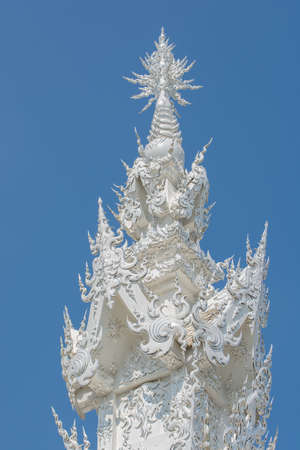 buddhist temple roof: Wat Rong Khun or White temple white buddhist temple roof At Chiangrai, Thailand Stock Photo