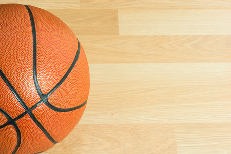 wood floor: Close up Basketball on wooden floor background