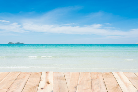 clouds background: Beauty holiday wood terrace on beach blue sky