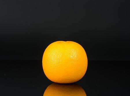 Fruity Raw Orange isolated on black background