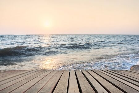 Beach Scene With Wooden Floor background can put or montage your products Standard-Bild