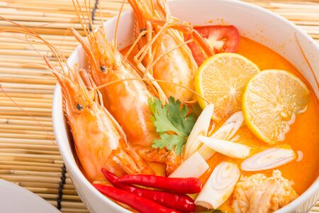 shrimp: Tom Yum Goong, Thai hot spicy soup shrimp on wooden background, Thailand Food