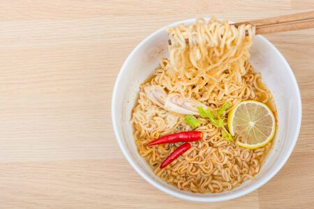cooked instant noodle: Hot and spicy lap instant noodle on wooden background