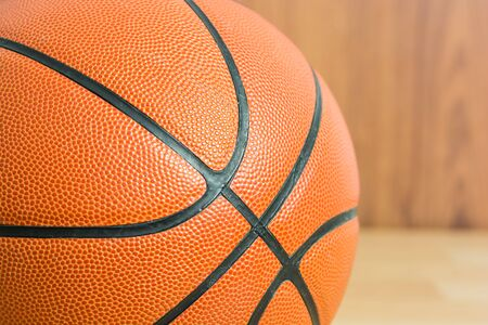 Close up Basketball on wooden floor background