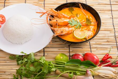 goong: Tom Yum Goong, Thai hot spicy soup shrimp on wooden background