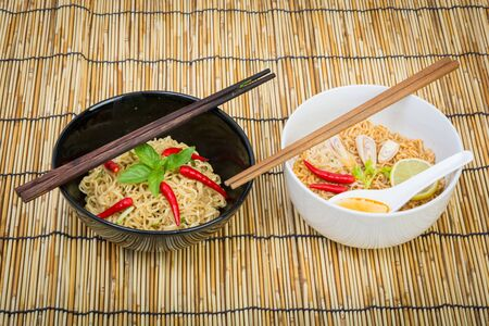cooked instant noodle: Hot and spicy instant noodle on wooden background Stock Photo