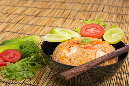 rice plate: Special Shrimp fried rice in black cup on table with wooden background