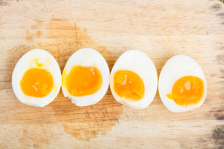 Organic Boiled Eggs Ready to Eat on wooden background