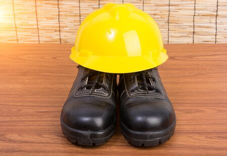 safety shoes: Top view safety shoes and composition of working tools on wooden table