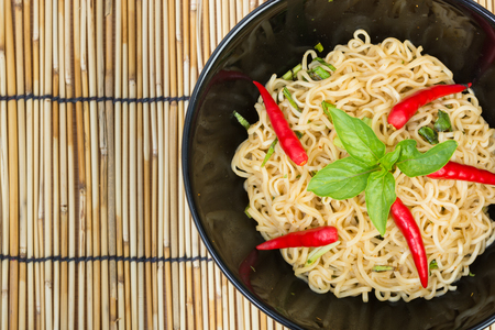 noodles soup: Hot and spicy instant noodle on wooden background Stock Photo