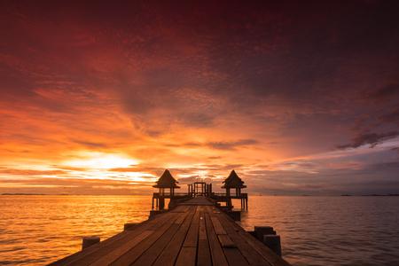 thailand: Twilight sunset wood bridge at Djittabhawan Temple tourist attraction in Pattaya, Thailand