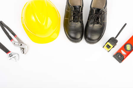 yellow hard hat: Yellow hard hat and tools on white background Stock Photo