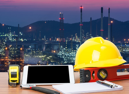 Working table engineer with tablet and tools in oil refinery industry business plant