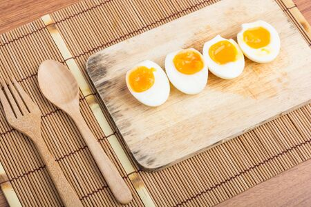 boiled eggs: Organic Boiled Eggs Ready to Eat on wooden background